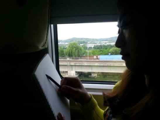 Michelle sketching during the train ride