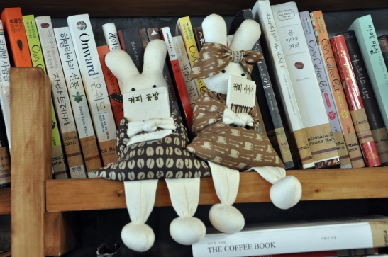 (6) Stuffed animals on bookcase